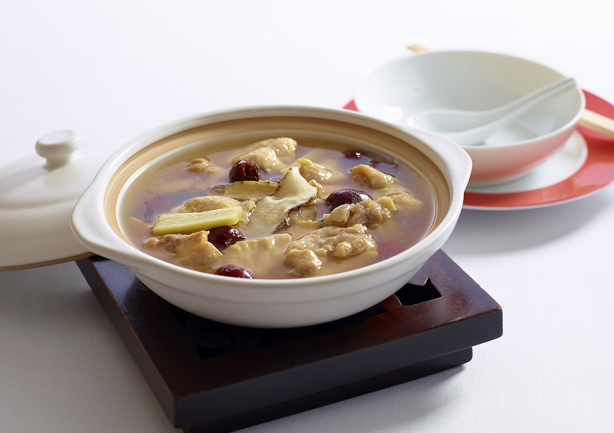 Warm up with a claypot chicken with ginseng, red dates and ginger.