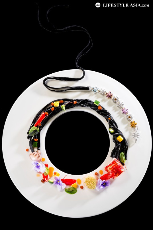The Bloom necklace's colours are strikingly brought out in the dish.
