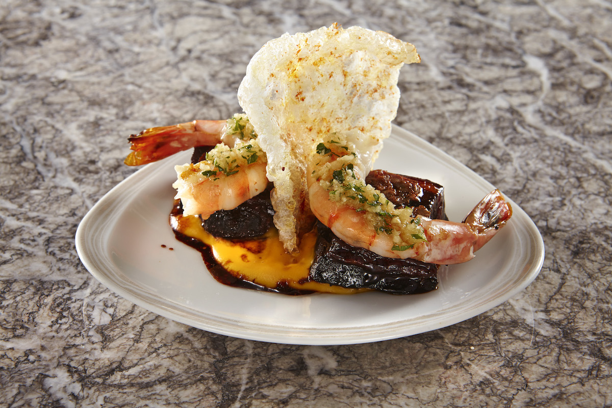 Caramelized pork belly and grilled prawns with sweet potato pureé ...
