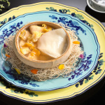 Summer pavilion ritz carlton singapore Double-boiled Sea Whelk soup with Fish Maw and Chicken Served in a Whole Coconut copy 2