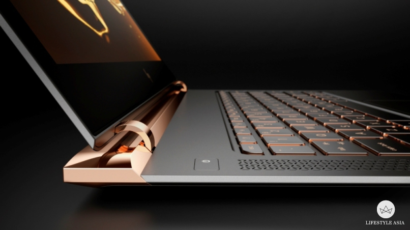 The HP Spectre's nearly-hingeless look is inspired by high-end furniture details.