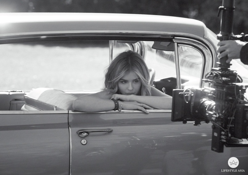 Chloe Grace Moretz smoulders at the camera on the set of the Coach Eau de Parfum campaign shoot.